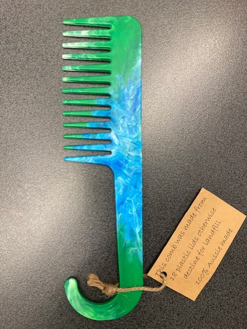 Comb made with 18 plastic lids from landfill by Precious Plastic Margaret River