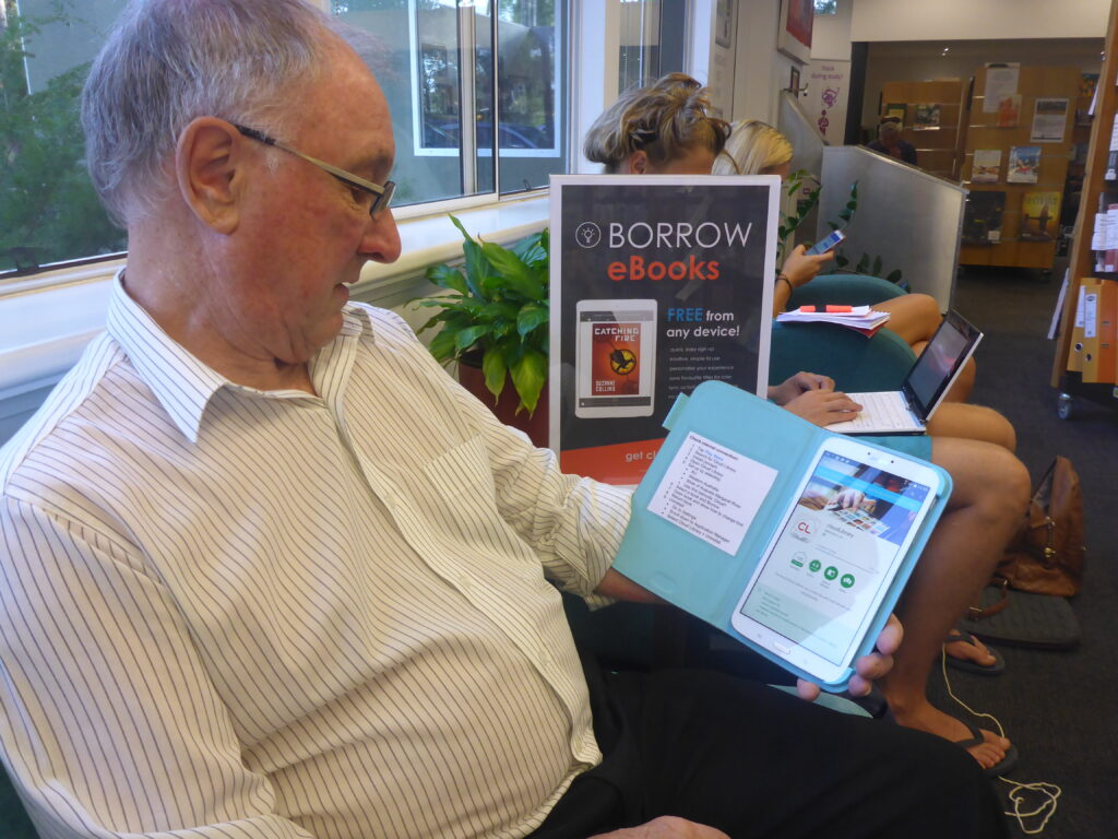 image of library member using an ipad device
